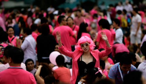 A woman dances as she takes part in a Pink Dot Sg event at the Speakers' Corner in Hong Lim Park in Singapore June 30, 2012. About 15,000 people took part in the event to promote acceptance of the Lesbian, Gay, Bisexual, Transgender community in Singapore. (Tim Chong/Reuters)